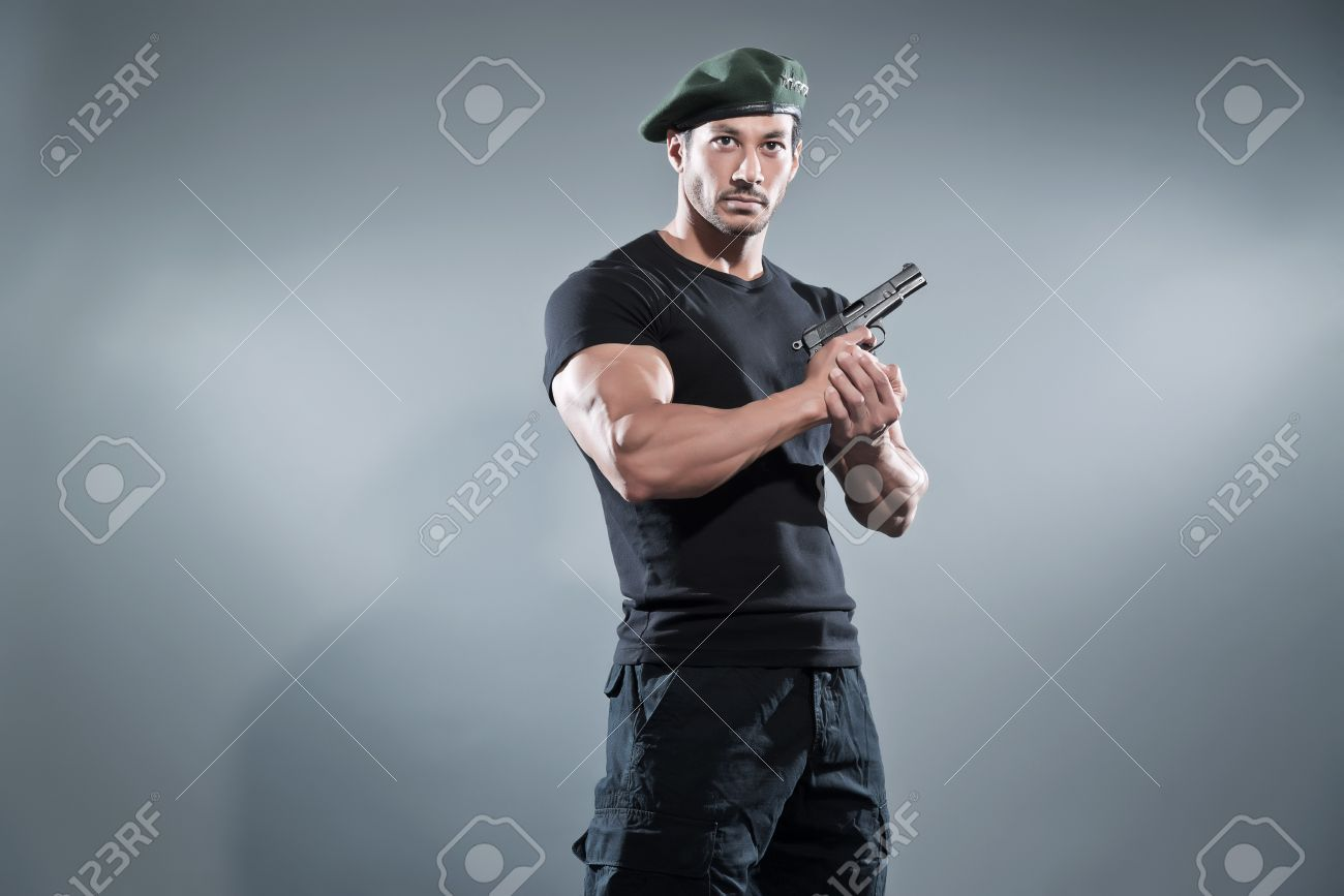 Black t shirt grey pants - Commander Muscled Action Hero Man With Gun Wearing Black T Shirt And Pants Studio