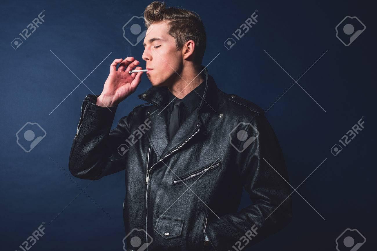 Cigarette smoking retro 50s rock and roll fashion man wearing
