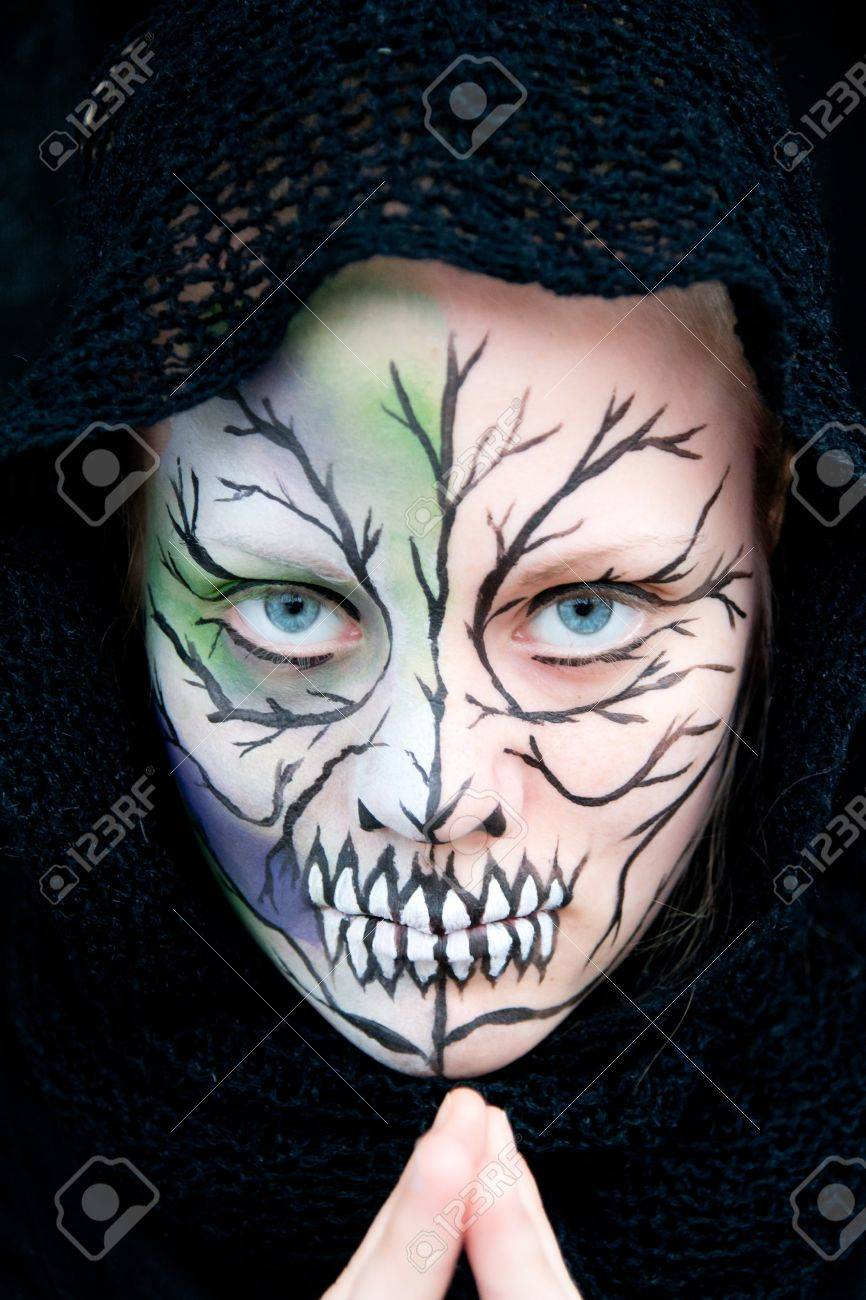 Crazy Painting Young Woman Who Looks Dangerous And Crazy With Halloween Face