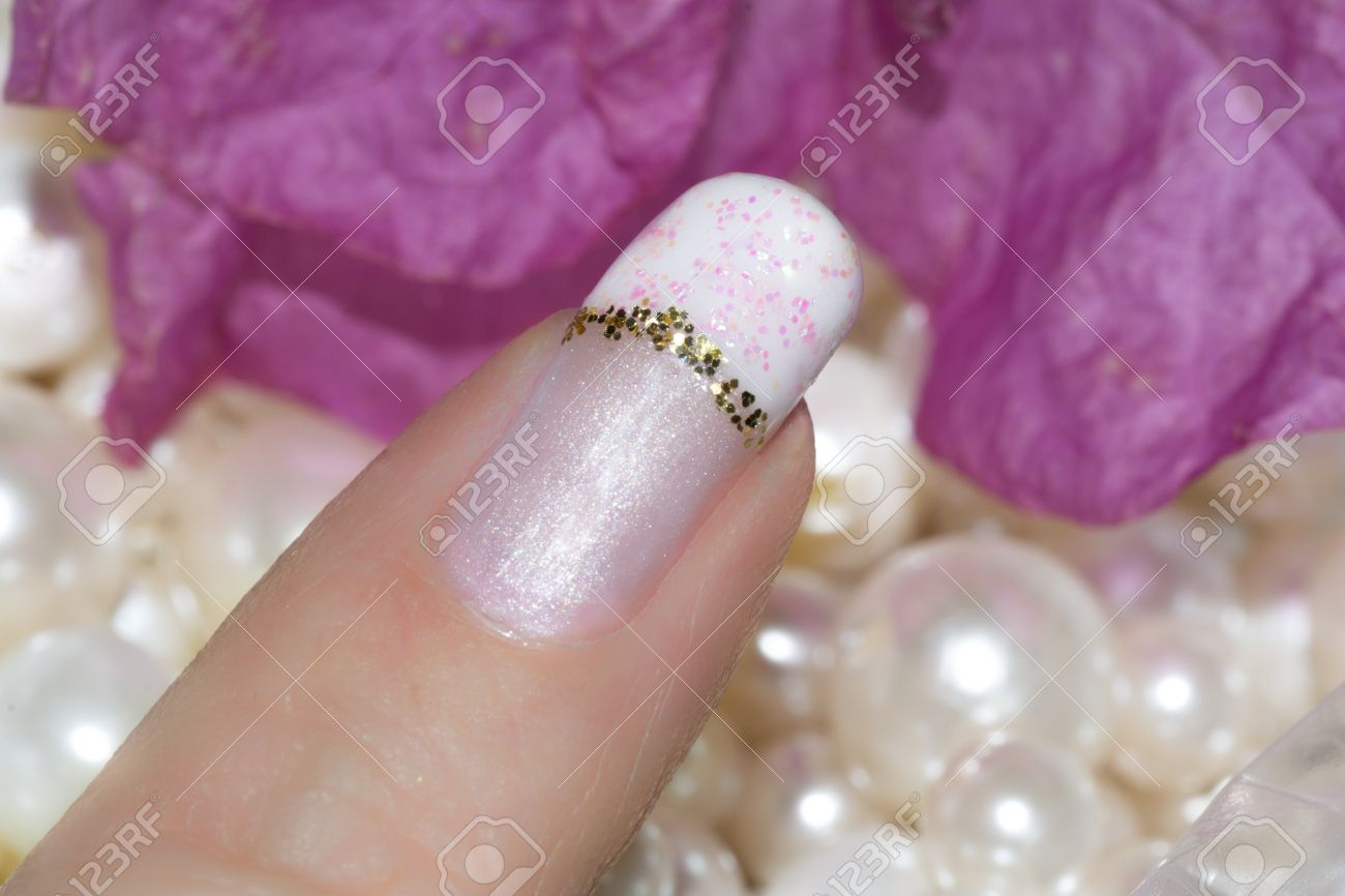 Nails With A French Manicure With A Gold Stripe And Pink Flakes ...