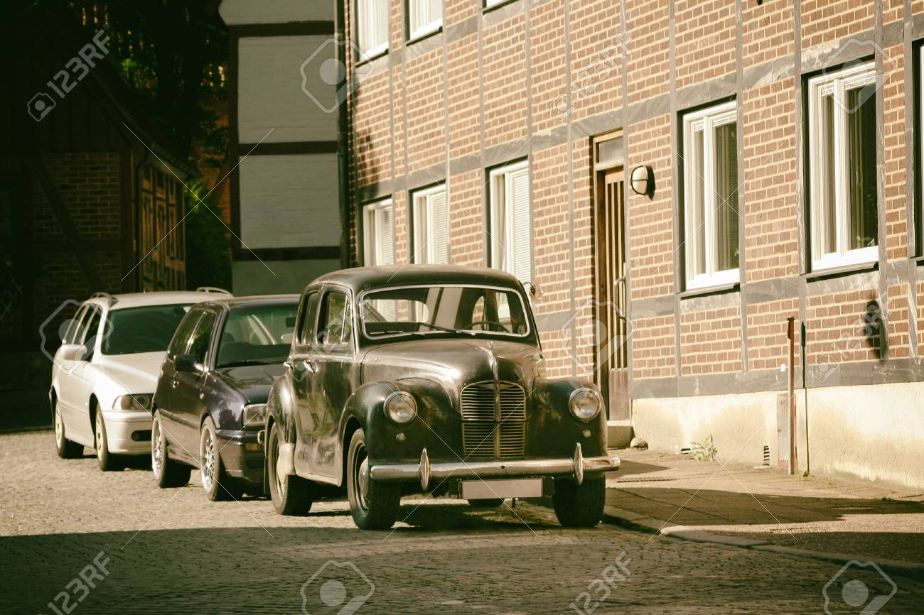 Old, Picturesque European Street With Cars Parked On The Left ...