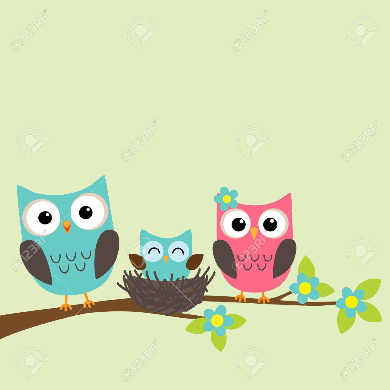 Family of owls with newborn owlet sitting on the branch of blooming tree - 52871074