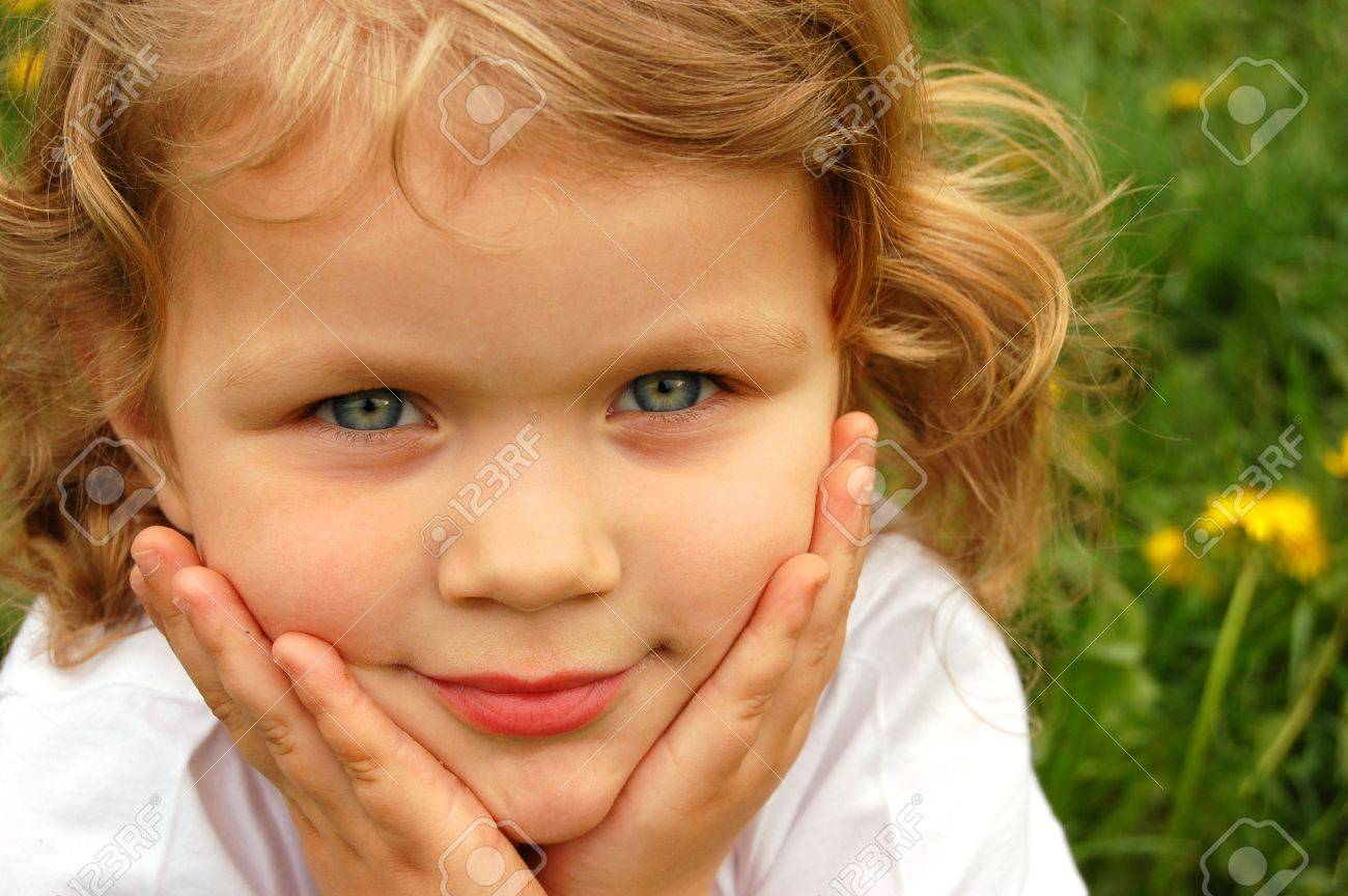 Portrait Of Small Pretty Girl With Curly Hair And Blue Eyes Stock Photo Picture And Royalty Free Image Image 3188561