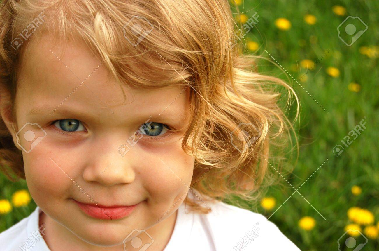Portrait Of Small Pretty Girl With Curly Hair And Blue Eyes Stock Photo Picture And Royalty Free Image Image 3188560