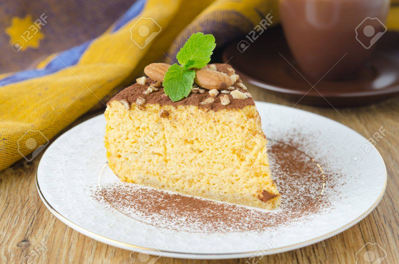 A Piece Of Pumpkin Cheesecake, Decorated With Almonds And A ...