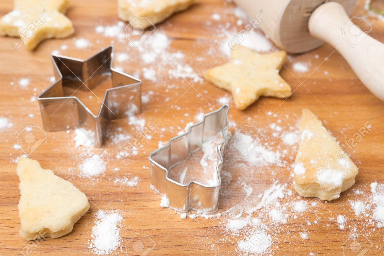 Christmas cookies and baking dish on a wooden board, selective focus, horizontal Stock Photo - 21192462