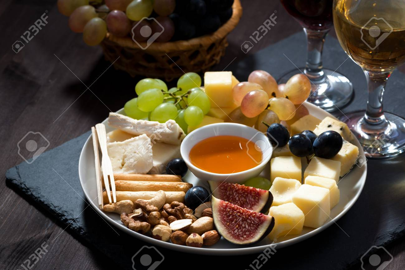 Plate With Deli Snacks And Wine On A Dark Background Closeup Stock Photo Picture And Royalty Free Image Image 48892116