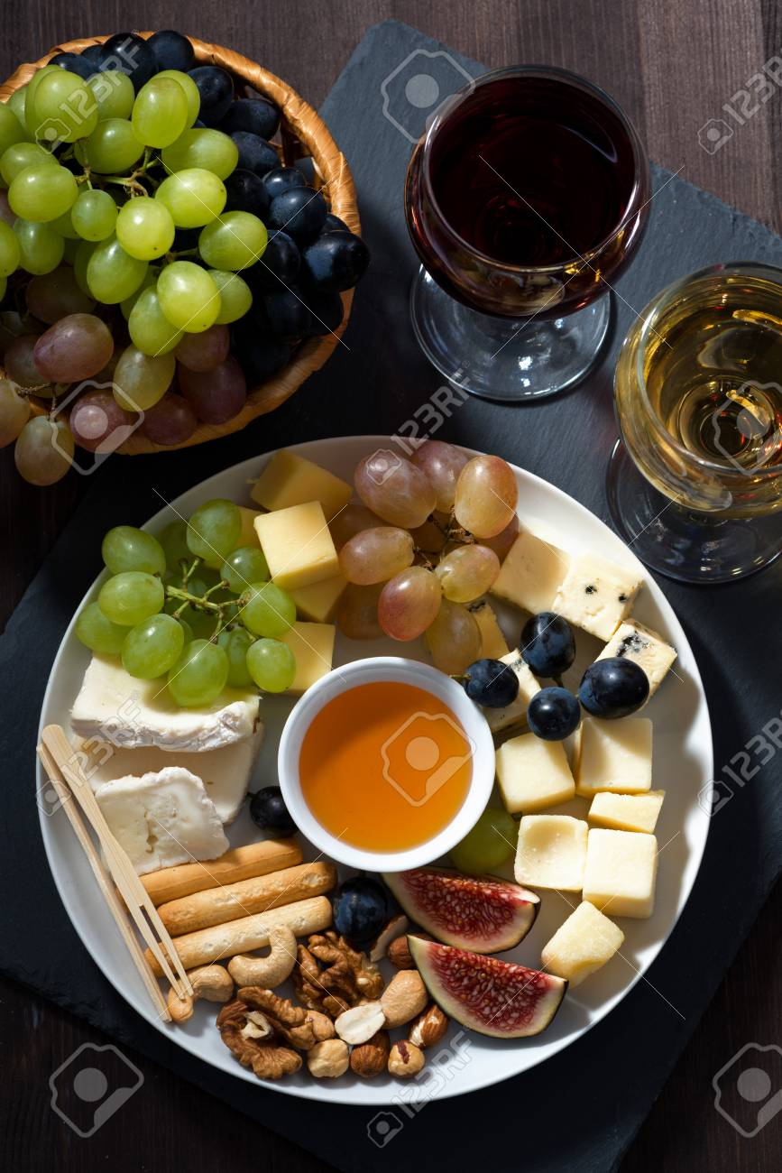 Plate With Deli Snacks And Glasses Of Wine Top View Vertical Stock Photo Picture And Royalty Free Image Image 48972724