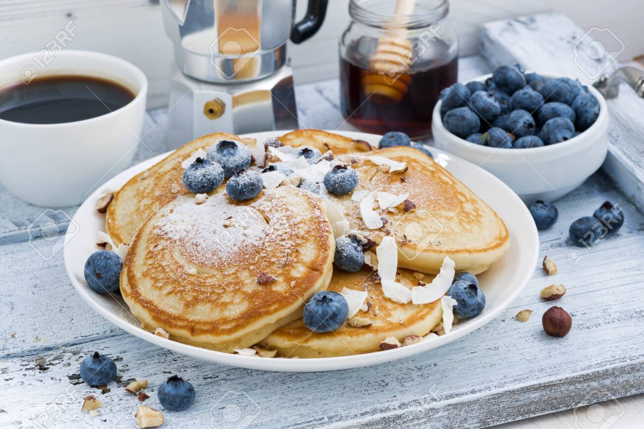 pancakes with fresh blueberries and honey for breakfast, horizontal - 147910734