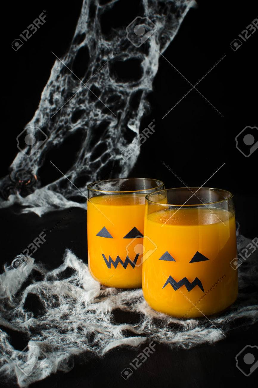 halloween drink pumpkin juice for children stock photo, picture and