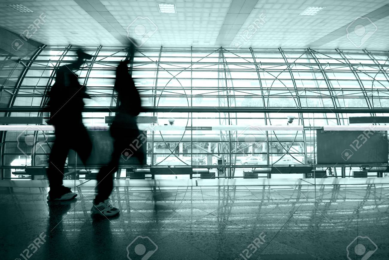 people rushing in airport Stock Photo - 5844765