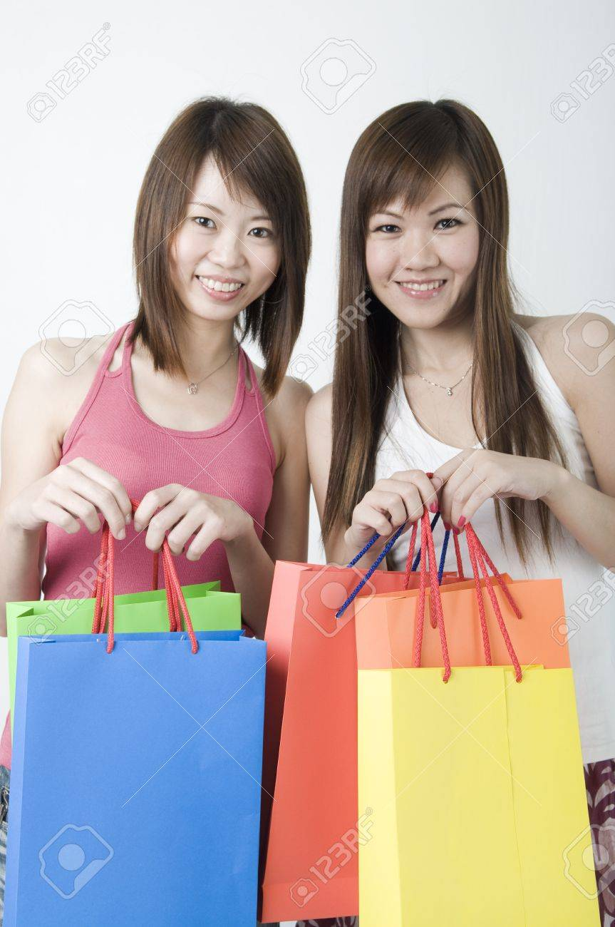2 Happy Asian Girls Smiling With Shopping Bags Stock Photo