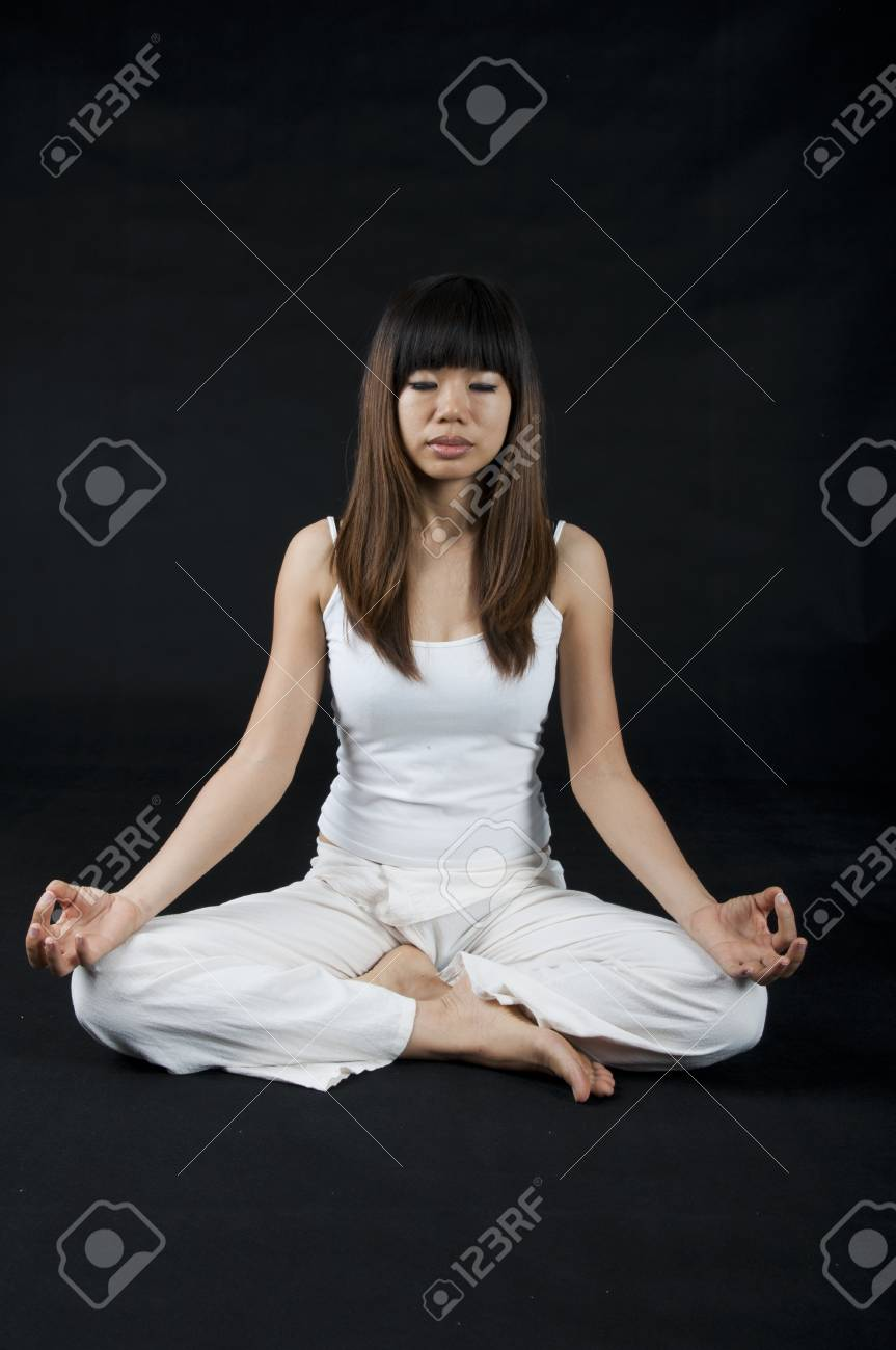 asian girl performing yoga with dark background Stock Photo - 8558202