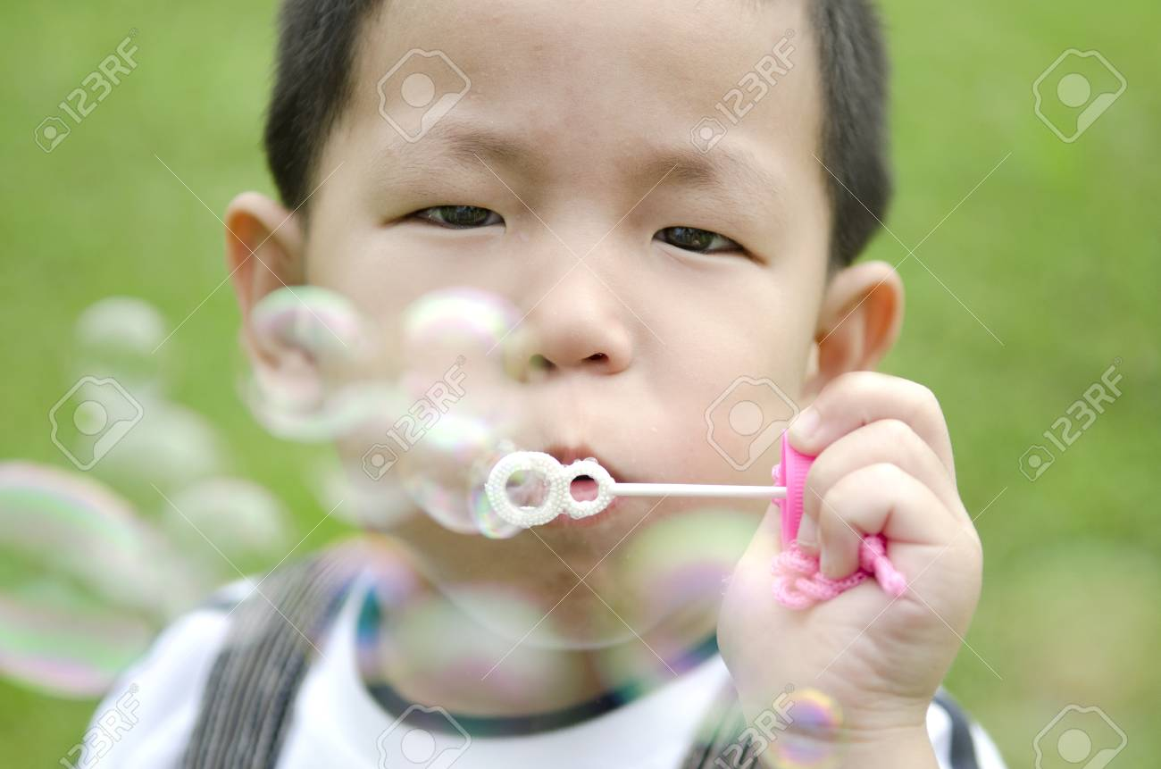 Kid Blowing Soap Bubbles Asian Kid Blowing Soap Bubble