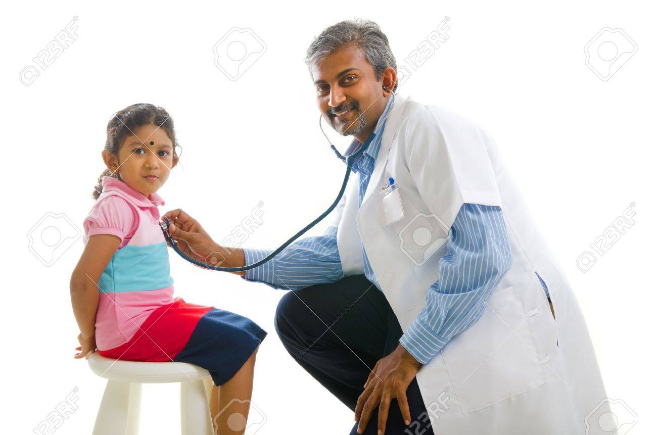 asian indian doctor with a young girl,medical check Stock Photo - 14975743