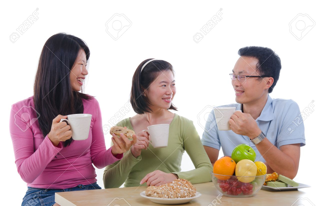 asian family dining iwht isolate white background Stock Photo - 16008925