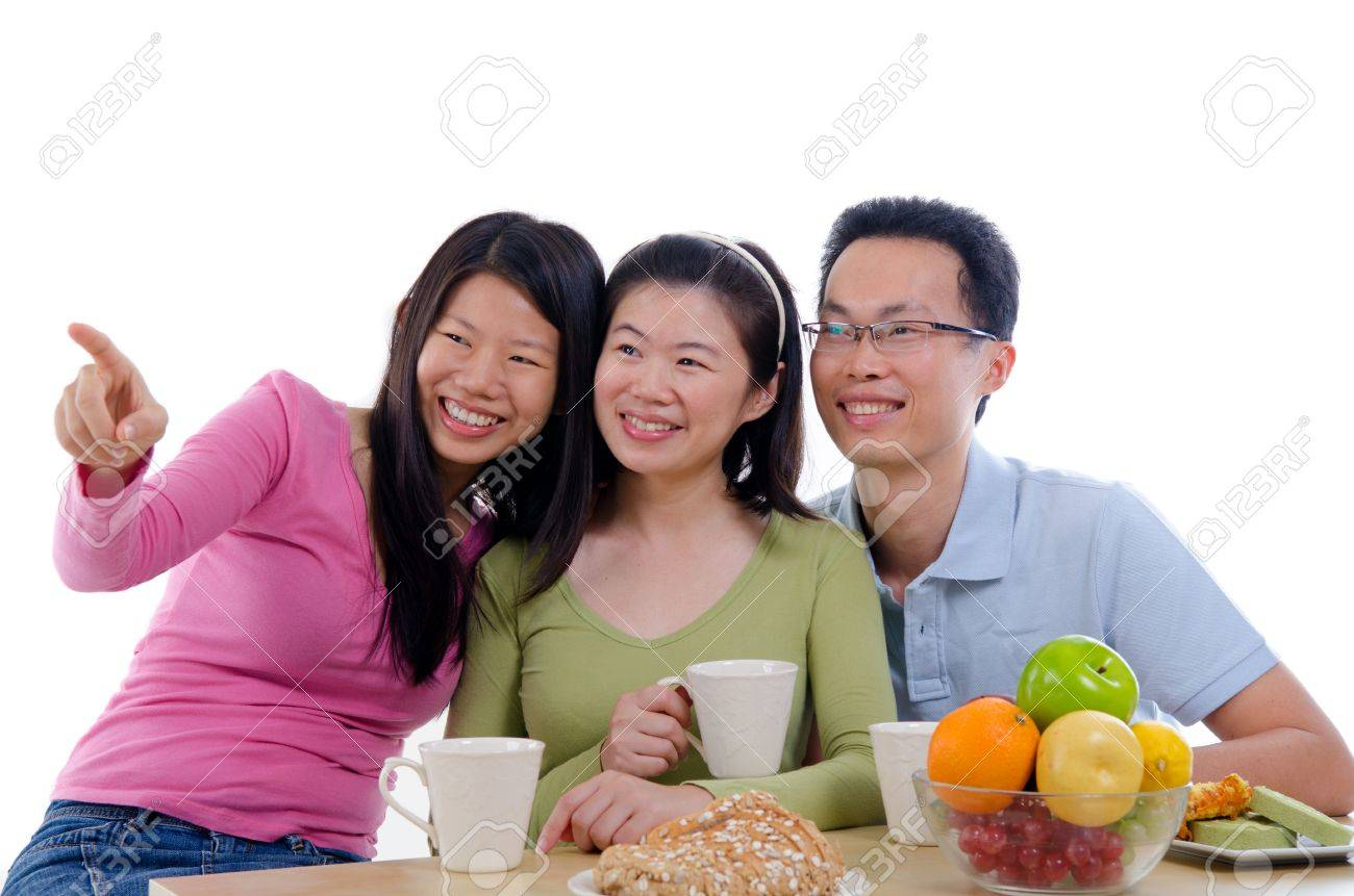 asian family dining iwht isolate white background Stock Photo - 16008918