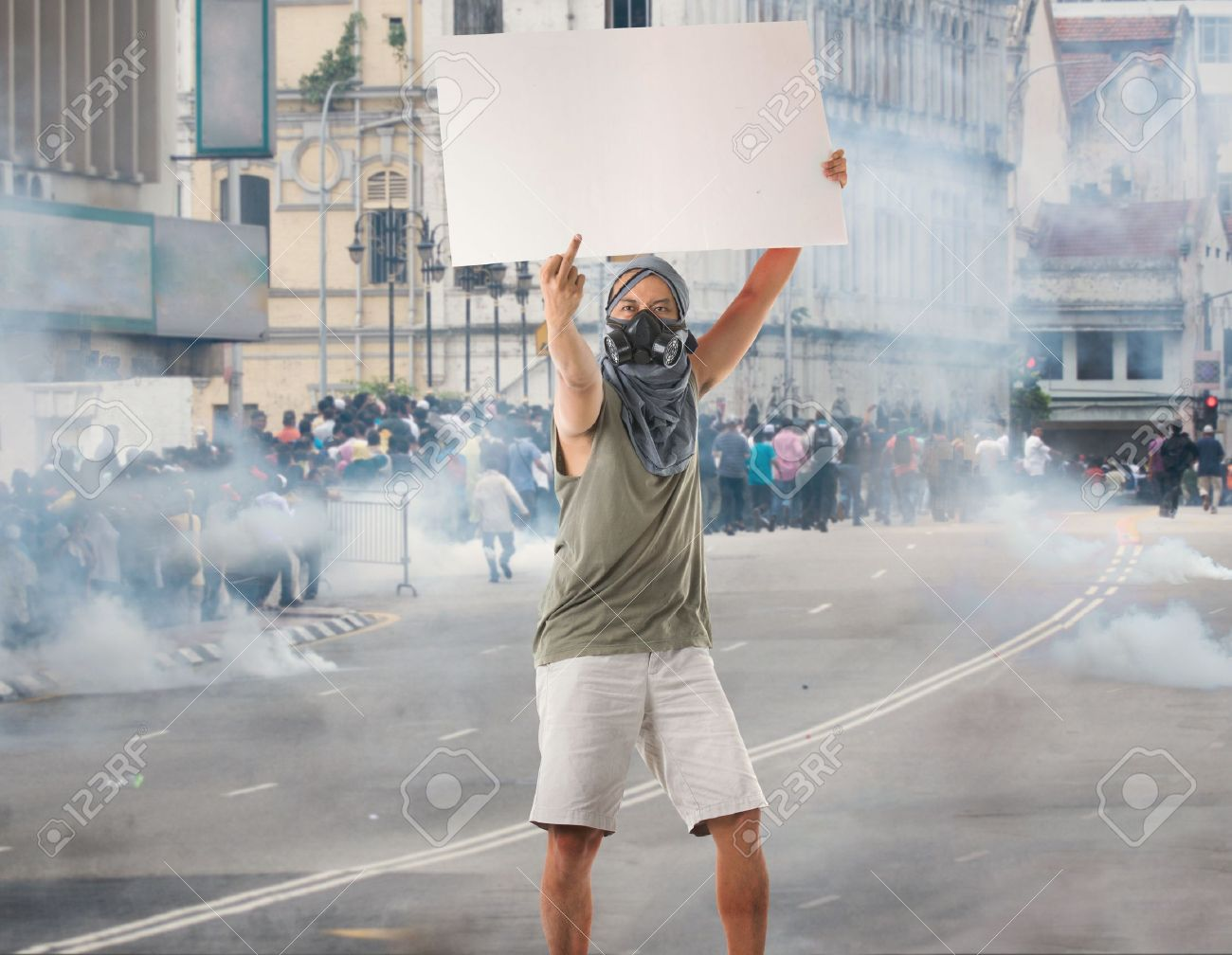 man in street protest with blank cardboard, looks great for advertistment with attitude Stock Photo - 17046367
