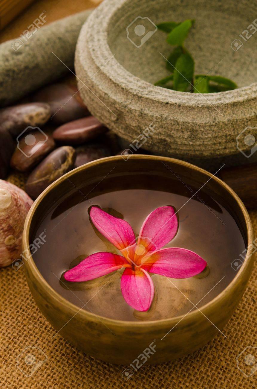 tropical spa setup with traditional frangipani flower and massage items Stock Photo - 18879422