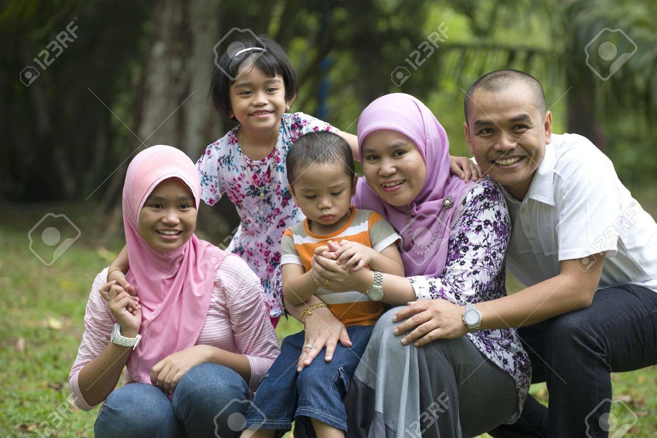 malay muslim family having fun in the park Stock Photo - 21232199