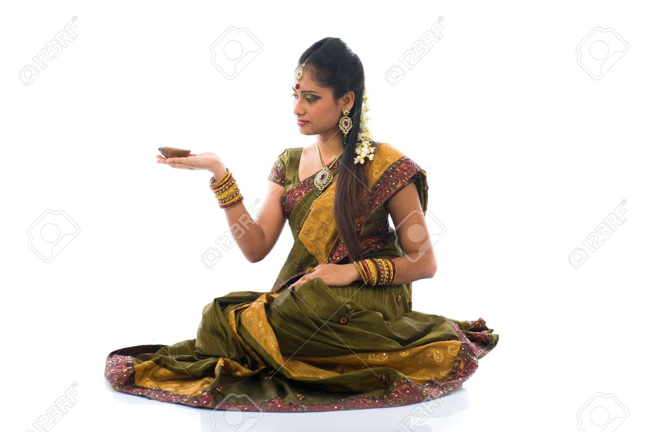 traditional indian woman with oil lamp during the celebration of deepawali or diwali on white background Stock Photo - 21577501