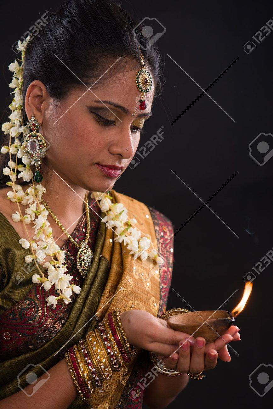 traditional indian woman with oil lamp during the celebration of deepawali or diwali Stock Photo - 21577514