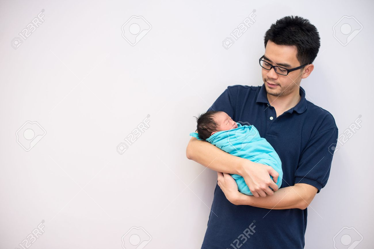 Asian chinese newborn baby girl and daddy in hospital Stock Photo - 22484801