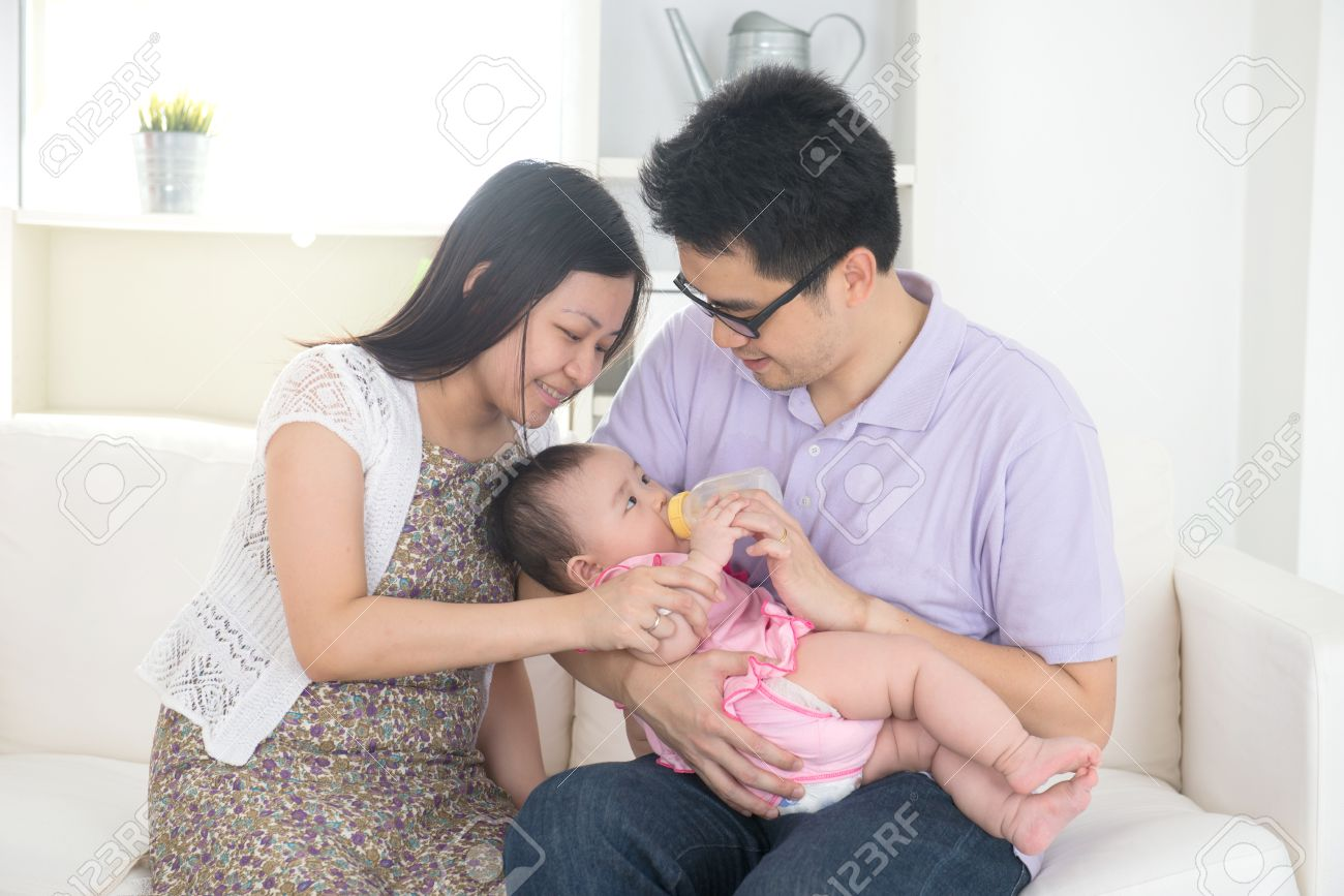 chinese asian parents feeding baby boy at home Stock Photo - 23873341
