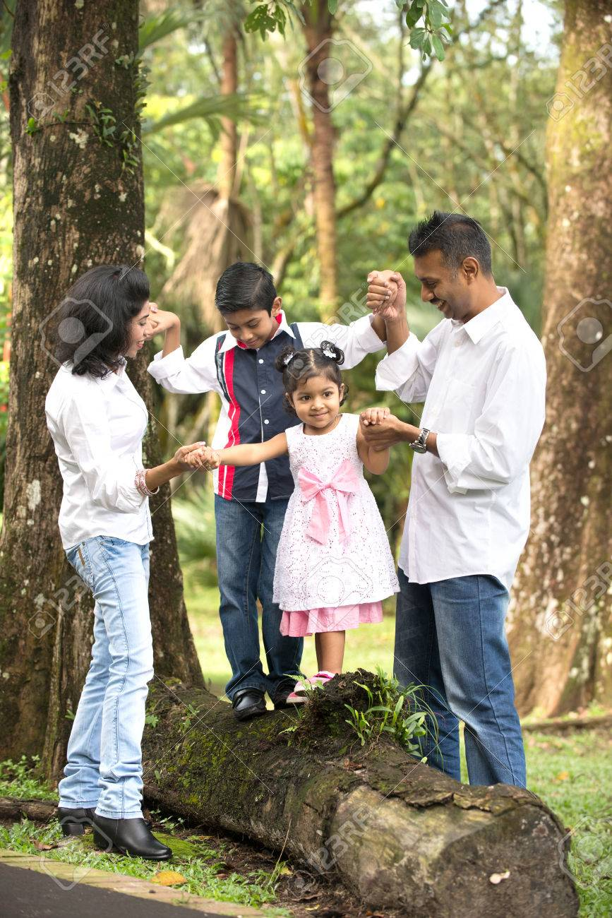 indian family teaching children to climb Stock Photo - 24944249