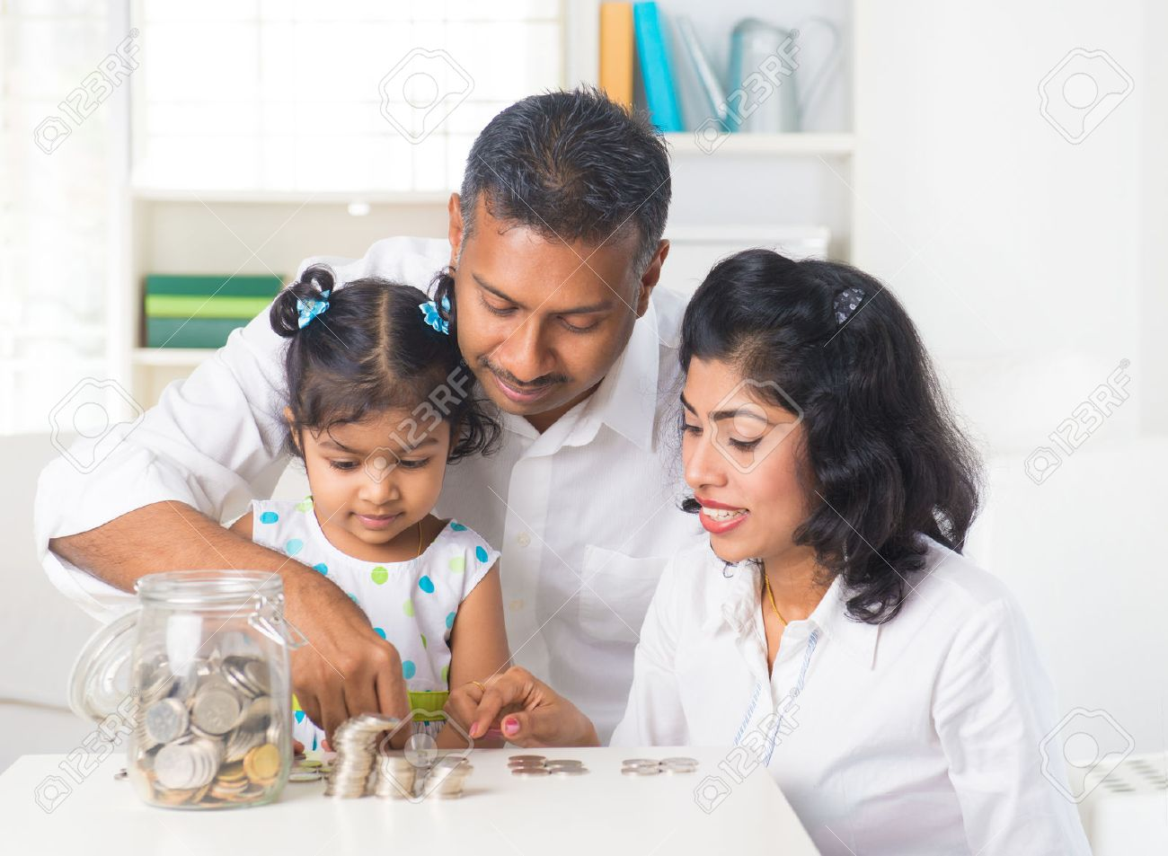 indian family teaching children on savings and financial planning Stock Photo - 24944256
