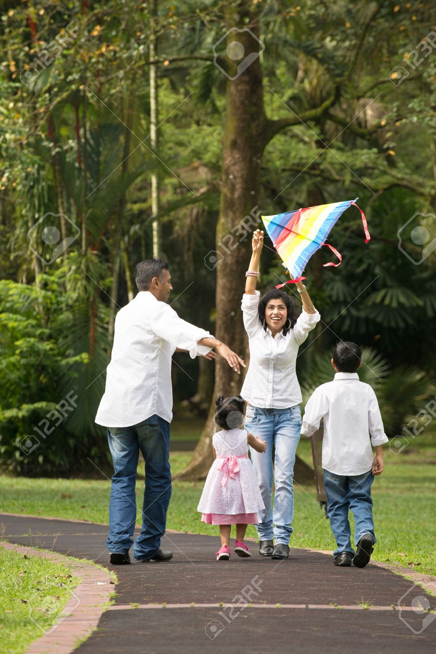 indian family playing kite in the outdoor park Stock Photo - 26880286