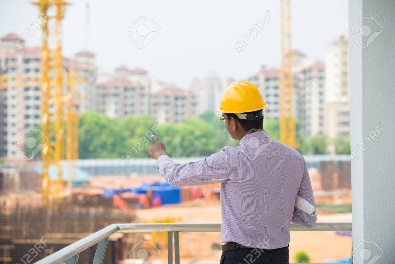 indian male architect inspecting site with construction background Stock Photo - 27083215