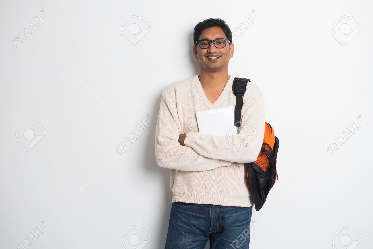 casual indian male student on a sweater and tablet Stock Photo - 28226353