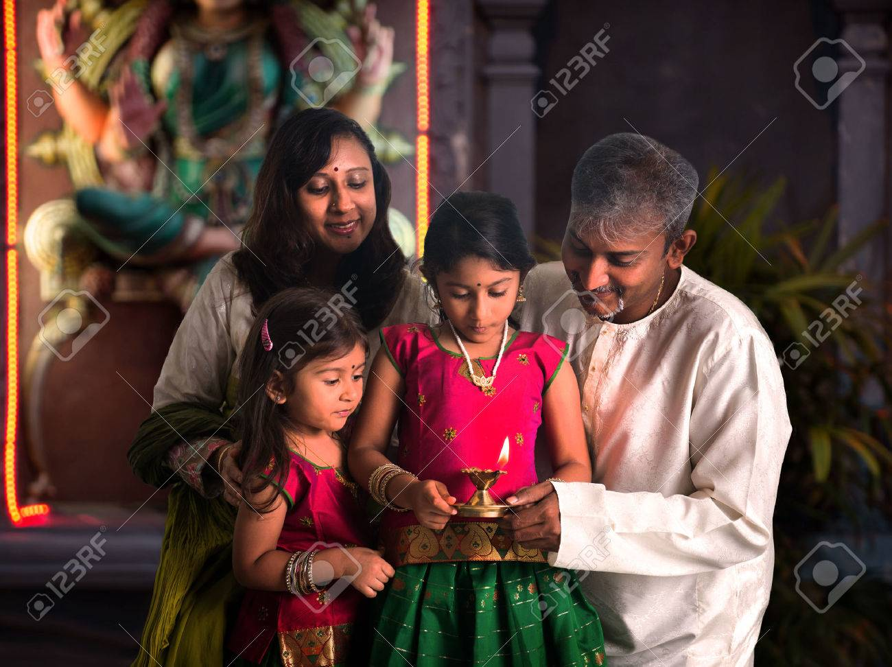 indian family celebrating diwali ,fesitval of lights inside a temple Stock Photo - 29089896