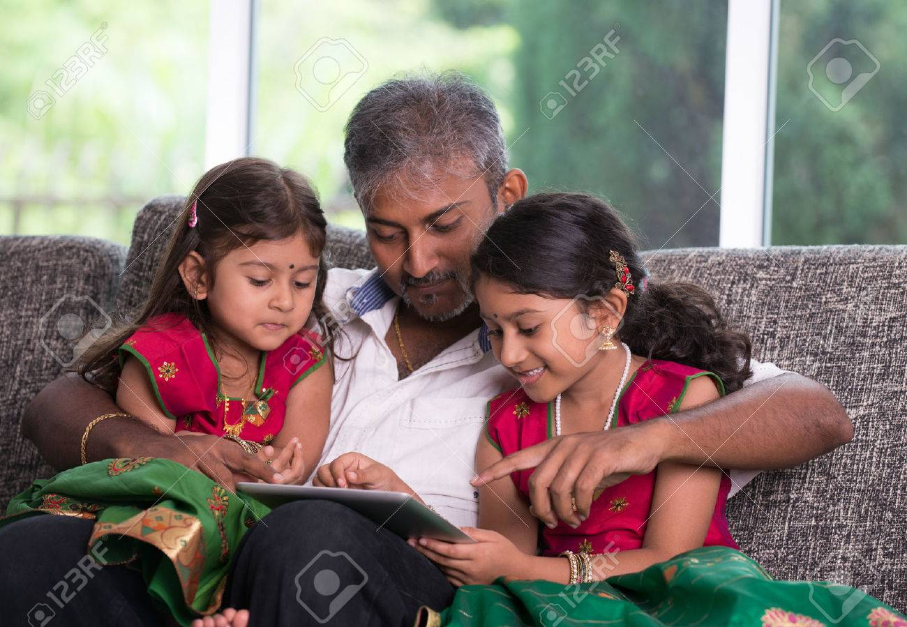indian father with his daughter using a tablet computer on living room Stock Photo - 29398908