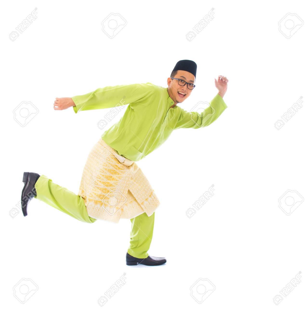 malay male jumping celebrating hari raya eid fitr after ramadan Stock Photo - 29822897