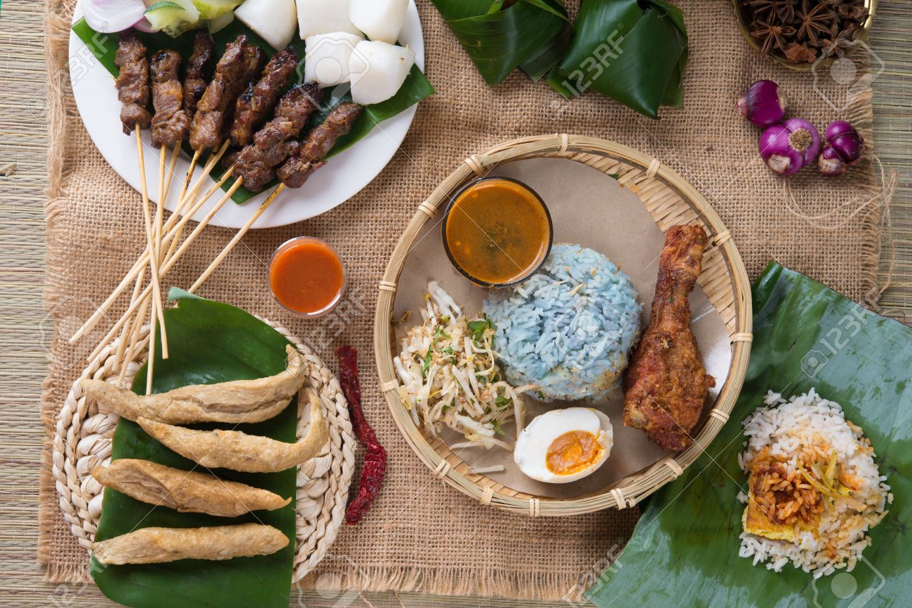 Traditional Malaysian food. Nasi kerabu is a type of nasi ulam, popular Malay rice dish. Blue color of rice resulting from the petals of butterfly-pea flowers. Asian cuisine. Stock Photo - 31532075