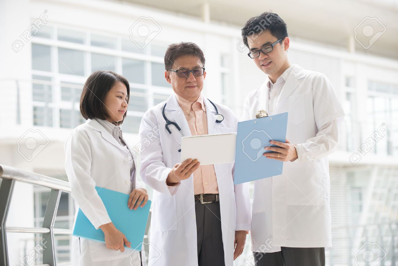 Asian medical team of doctors meeting  inside hospital building Stock Photo - 32358221