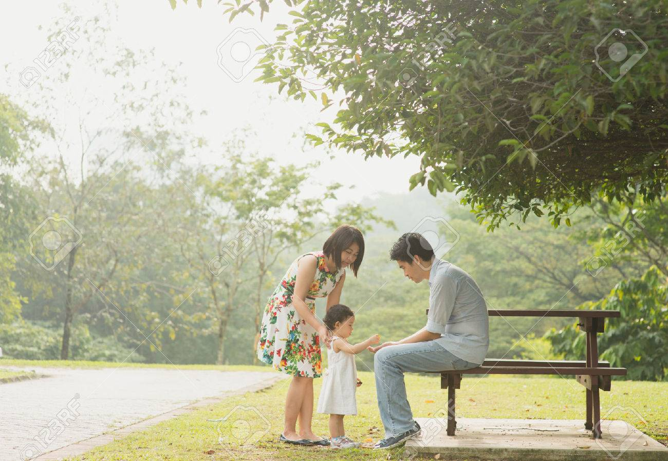 Happy Asian Family enjoying their time in the park Stock Photo - 37453256