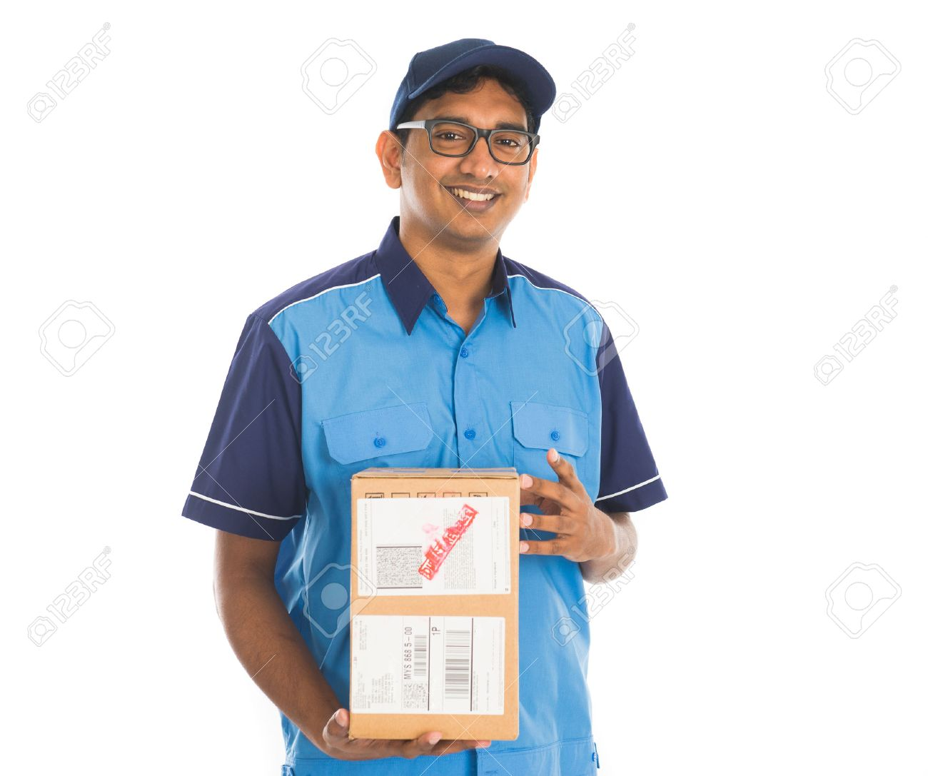 indian delivery man in blue uniform stock photo picture and royalty
