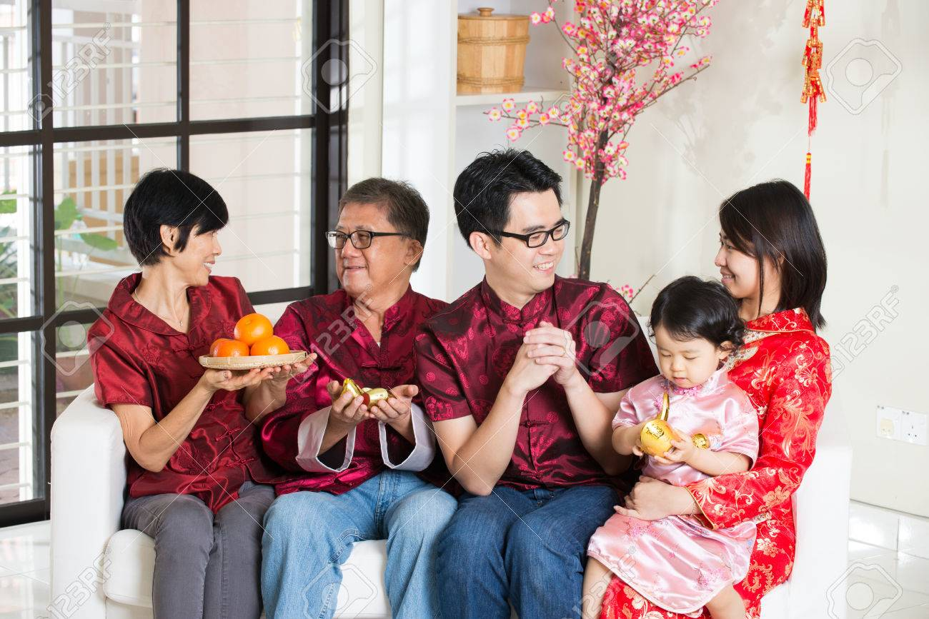 asian family with chinese new year greetings stock photo 47187564
