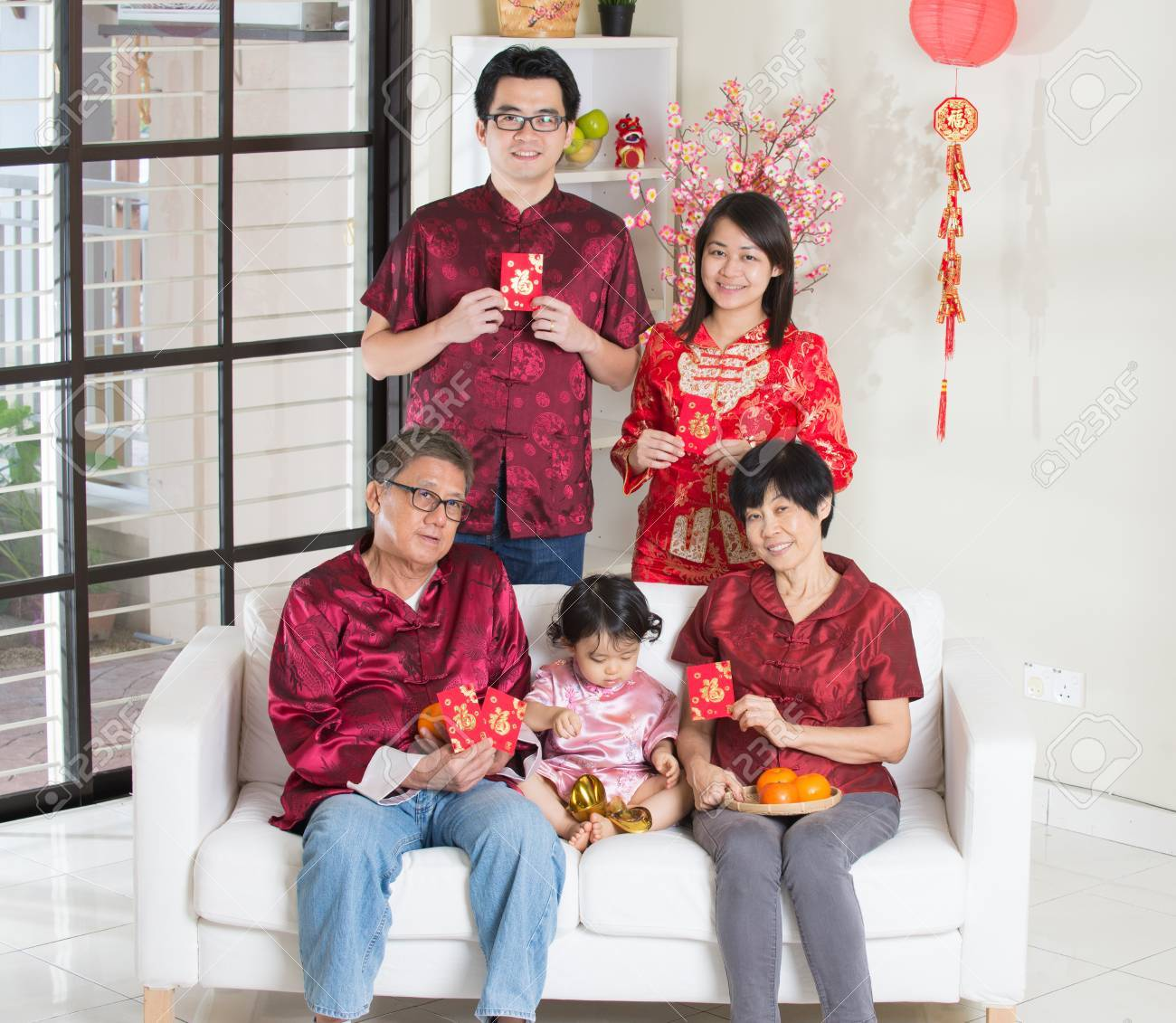 asian family with chinese new year greetings stock photo 47187577