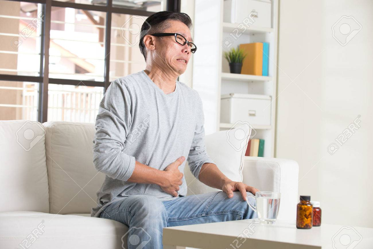 asian senior with stomach pain and medicine Stock Photo - 48438677