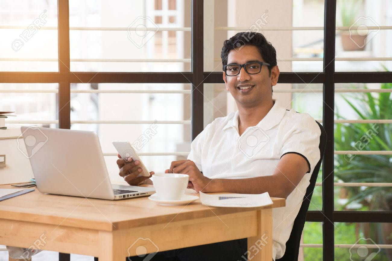 young indian man working from home office Stock Photo - 57997227