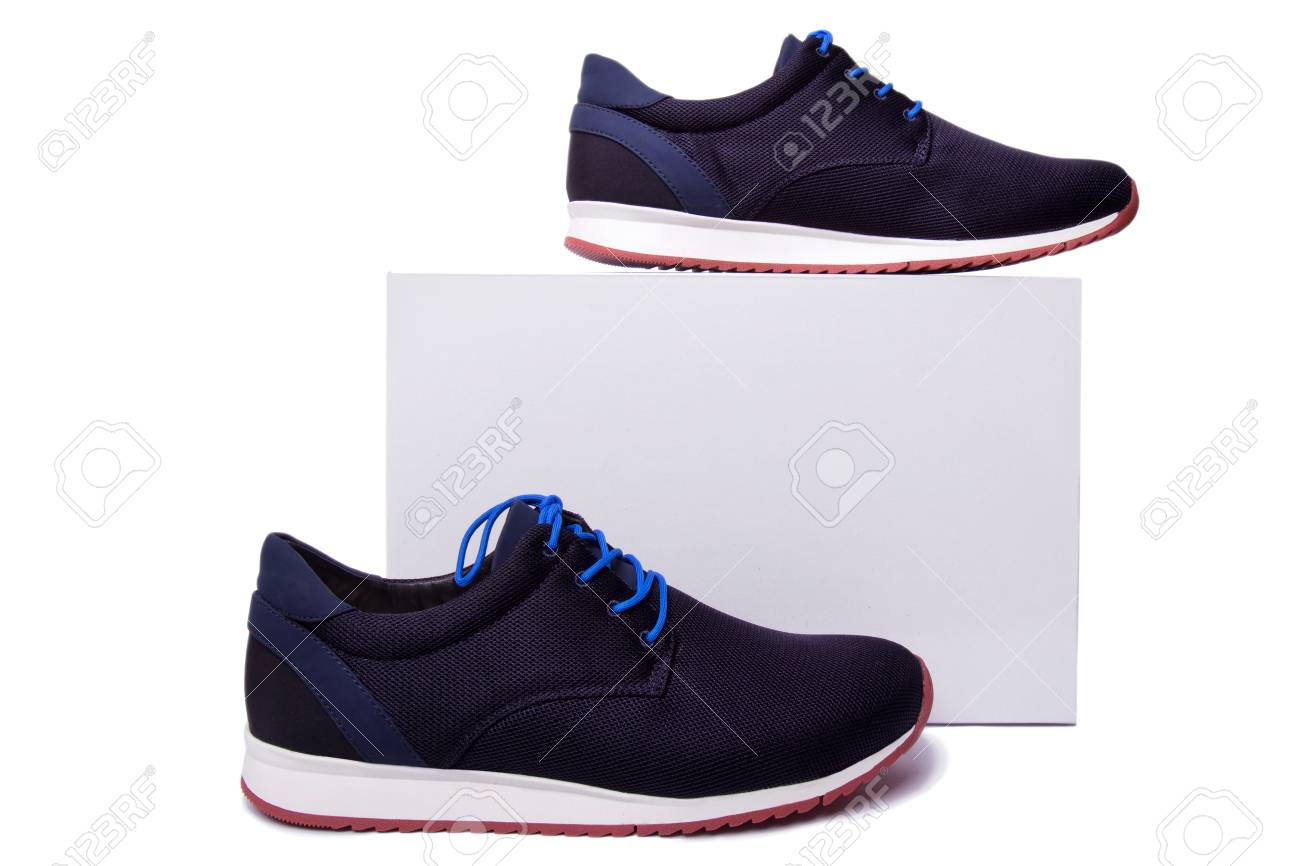 black and blue mens sport shoes near the white box. Isolate on white. - 76156187