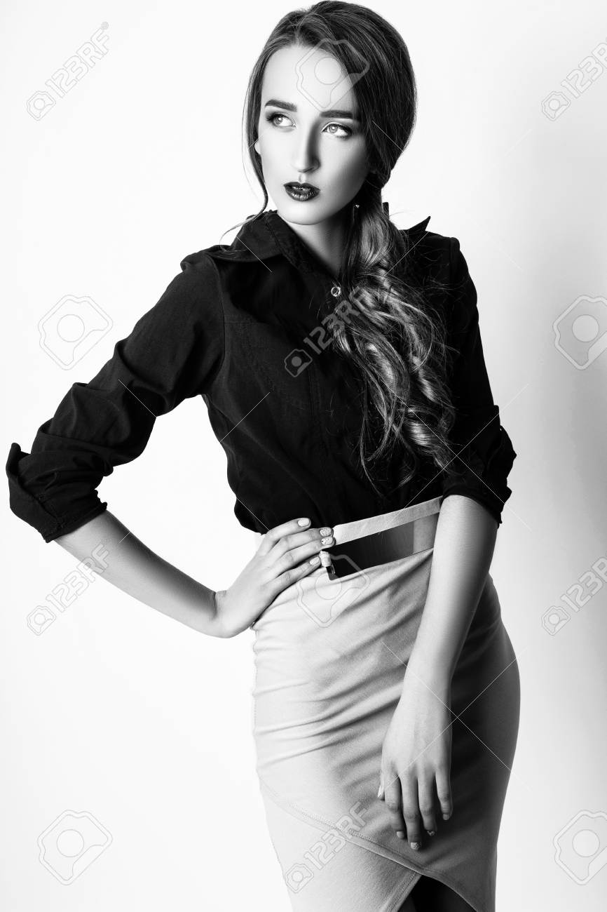 Fashion photo of young magnificent woman on white background