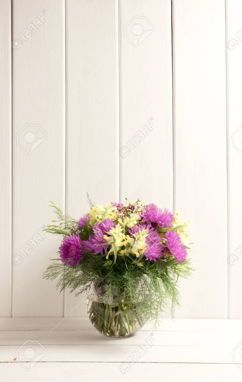 Flower Bouquet In Glass Round Vase On Background Of White Wooden Stock Photo Picture And Royalty Free Image Image 77460021