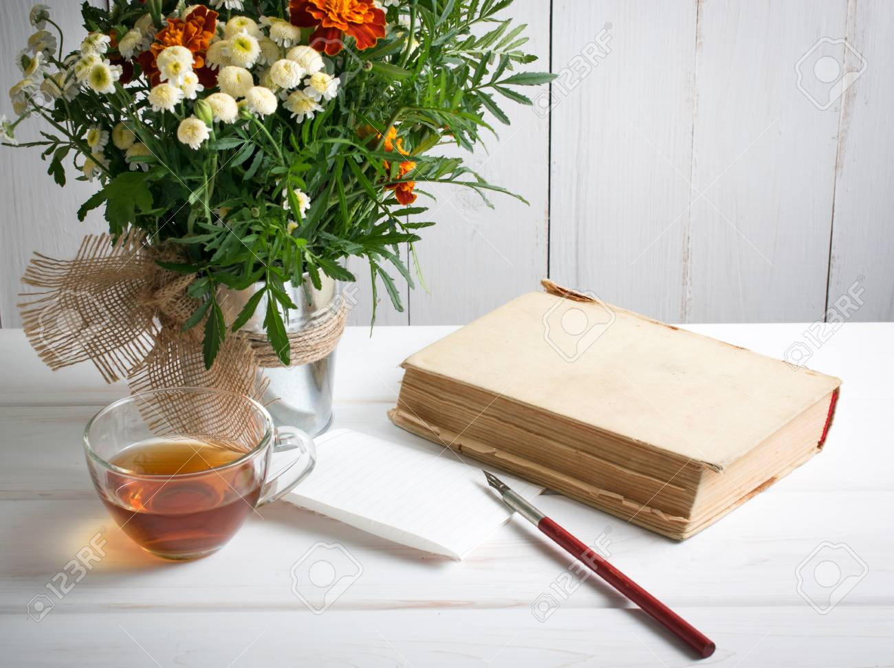 Tagetes Flower Bouquet With Old Book And Cup Tea And Nib Pen.. Stock ...