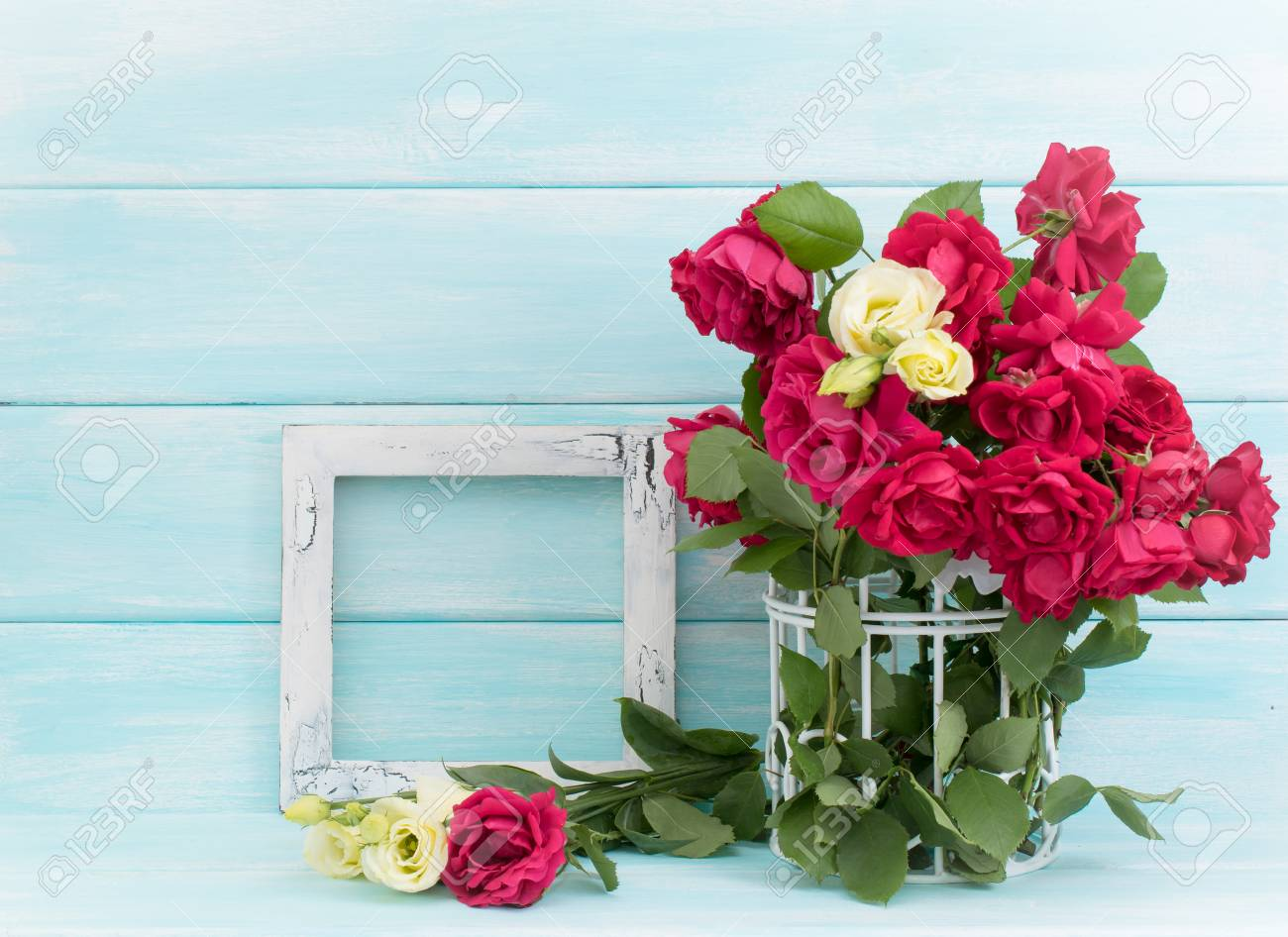 Roses In Birdcage And Vintage Photo Frame On Wooden Background ...