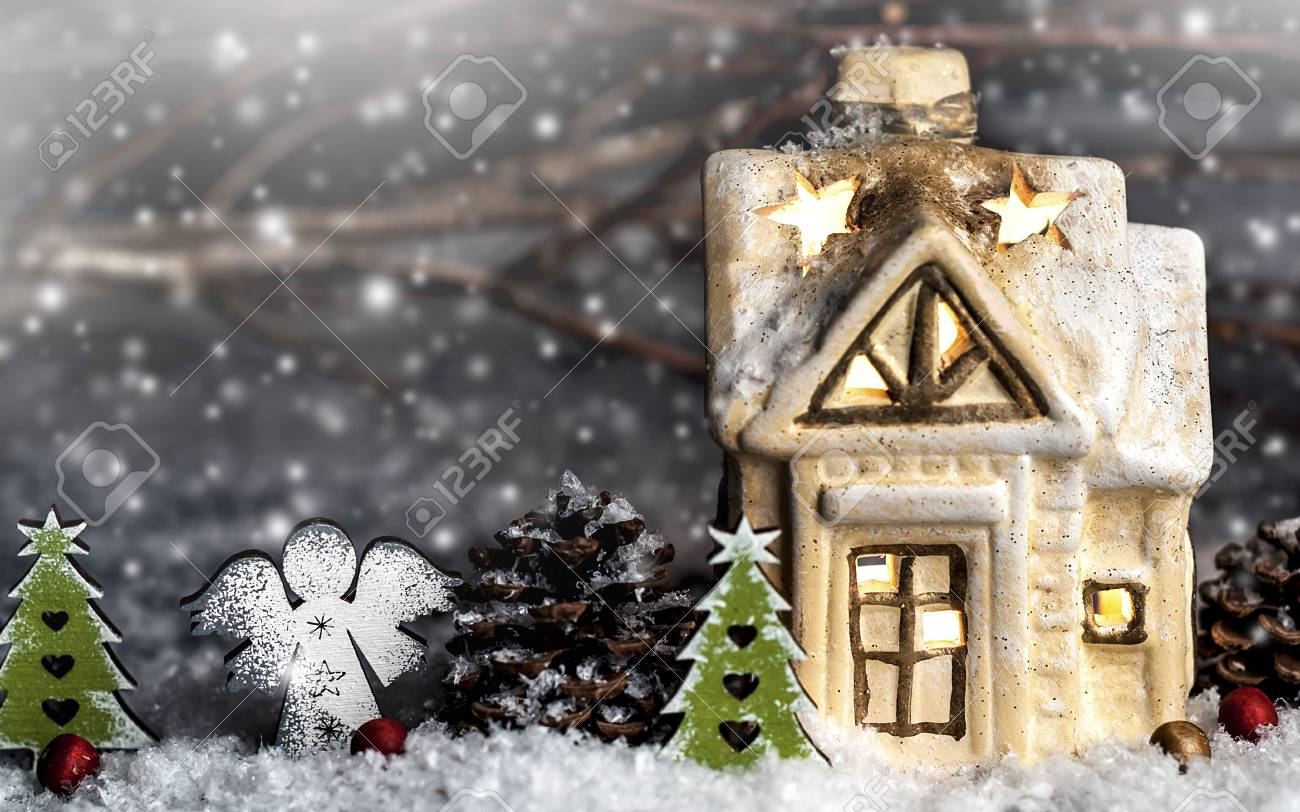 Decorative Christmas Decorations Small House On A Snowy Background Stock Photo Picture And Royalty Free Image Image 91806626